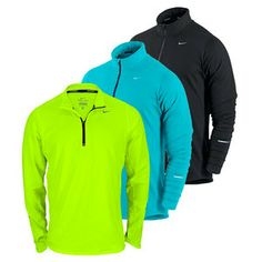 Bold colors for this pullover get you noticed! NIKE Men`s Element Half Zip Running Top