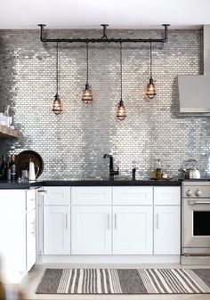 7 Ways With Metro Tiles To Avoid Being A Design Cliché #refinery29 http://www.refinery29.uk/metro-tiles-ways#slide-5 Good To GlowKitchens don't get much hotter than this. Here, mini metro tiles in a metallic finish create a statement that's pure Studio 54. Glass, metallic and mirrored tiles add glamour to any space, but they also have the added bonus of creating the illusion of more light and space – the next-level metro tile, if you will....