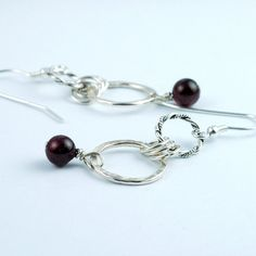 just created these today. i'm in love with red gemstones!   garnet and recycled sterling silver