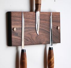 Walnut magnetic knife rack from Meriwether of Montana. A classic, must have item for any kitchen. This hand made, walnut knife rack has 6 astonishingly strong rare earth magnets embedded in the wood to securely hold any knife or utensil found in the kitchen... even large cleavers or butcher's knives. Handcrafted in our wood shop in Whitefish, Montana. Makes a great housewarming gift idea or wedding gift idea.