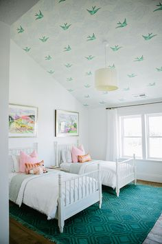 Wallpaper. The wallpaper adds visual interest that is too complex to paint by hand and its function is to make the room more informal for the bedroom to make it a relaxing space.