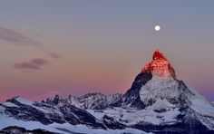 The Matterhorn mountain(Italian & Swiss Alps) at sunrise under the Harvest moon.  Mark Andreas JonesⒸ