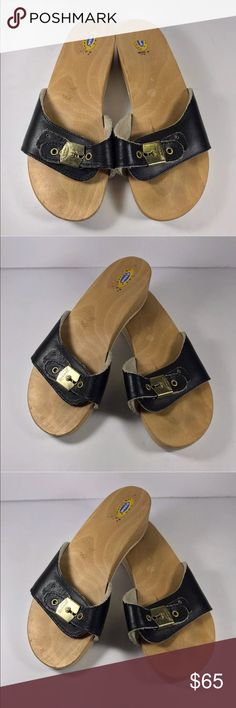 """Dr. scholls navy leather wood exercise sandals Original Dr. Scholl's Exercise sandals Wood and leather Leather is a navy blue Adjustable buckle strap Size 7 Made in Italy Barely used, vintage condition insoles are 9.5"""" long  Check out my other listings for more great things in your size Dr. Scholl's Shoes Sandals"""