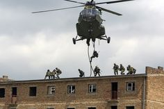 Polish and Canadian soldiers practice fast-roping from a Polish helicopter onto a building during Operation REASSURANCE June 2016 [4060 x 2707]