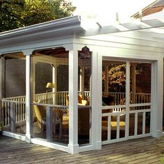 A low maintenance screened in structure on top of a deck creates a protected and carefree outdoor living space.
