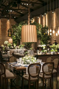 Trees, mix of seating, soft lighting Wood Wedding Decorations, Reception Table Decorations, Rustic Restaurant, Restaurant Design, Indoor Wedding, Cafe Interior, Event Decor, Table Settings, Oasis Shop