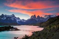 Beautiful sunset view at Lake Pehoe of the Torres del Paine National Park. Special type of clouds (Lenticular clouds) created a wonderful red sky above the Chilean Patagonia's mountain peaks. Beautiful Places In The World, Places Around The World, Great Places, Around The Worlds, Parc National Torres Del Paine, Patagonia Mountains, Lenticular Clouds, Chili, Reserva Natural