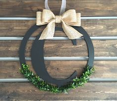 A personal favorite from my Etsy shop https://www.etsy.com/listing/461438812/letter-wreath-boxwood-wreath-monogram