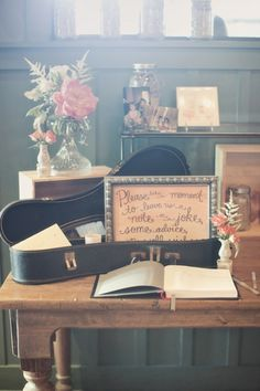 Such a sweet handwritten sign, and I love how they used a small instrument case for guests to tuck advice, notes, or jokes into!