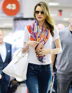 Miranda Kerr knows how to style a lightweight fall scarf!