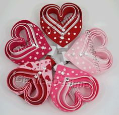 Valentine's day Heart Ribbon sculpture bow w / original swarovski crystal/ hair clip. $6.95, via Etsy.