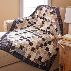 Use an unexpected mix of batiks and prints to add depth and scrappiness to a wall hanging. Careful placement of light and dark fabrics makes a checkerboard look that grows darker in the corners.