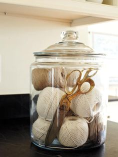 Emerson Made In Plain Sight | TheNest.com  Emerson uses string and scissors often, both for work and for gifting projects, so she keeps them front and center on the kitchen counter in a glass jar.