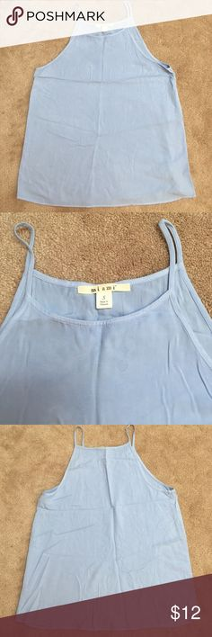 Francesca's Baby Blue Tank Racer back tank with higher neckline. Worn a couple times in good condition. Small spot on the back towards the bottom and a little at the top. Never washed so it may come out with some stain remover! Great for layering or wearing alone Francesca's Collections Tops Tank Tops