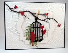 Delicate little bird cage card from the ever so talented jaydekay.  Check out that wonderful texture from the Sizzix embossing folder!