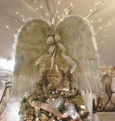 Angel Wings Tree Topper::An unusual idea, but put a Head with a Halo on those wings, attach them to a Glittery/Lacey decorated Tabletop tree and I see a mini Angel Tree here. Christmas Tree Toppers, Christmas Angels, Xmas Tree, Winter Christmas, Christmas Tree Decorations, Christmas Crafts, Christmas Ideas, Church Decorations, Holiday Decor