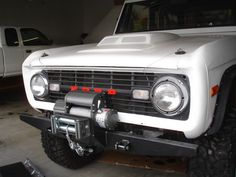 Classic early Ford Bronco, love the white, red & black.