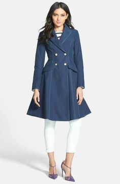 """Feminine and practical, the Manhattan skirted trench in navy will complete your look for a day spent marveling at the sculpture garden."" – SJP 
