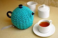 "Copyright 2014, Alessandra Hayden    Fits a standard 44oz teapot   Gauge:  7 sc and 6 rows = 2""   Stitch Guide:  ch - chain, hd..."