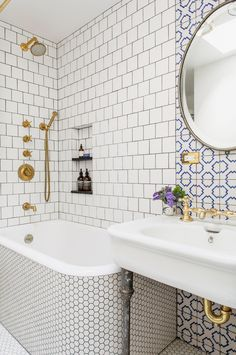 This small bathroom from Elizabeth Roberts Architecture & Design combines different tile shapes and patterns for an adventurous statement.