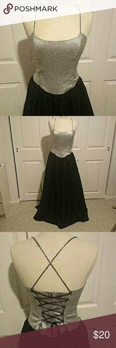 Beautiful formal dress Floor length dress with silver and black bodice, black skirt. Used but still has lots of life. 2 mended places in netting where heel caught (between skirt and slip ; doesn't show or effect look). Tag says size 13, but I think it runs small. Ask if you want measurements. Great for prom, homecoming, any formal event. Dry clean only. Nadine Dresses Prom