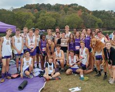 Members of the Cross Country team celebrate at the Region meet. Boys finish second and girls fifth