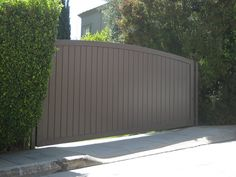 We install & repair wooden, steel, and vinyl gates in Los Angeles. Automatic wood driveway gates, wood fences or any custom safety gates. Electric Driveway Gates, Driveway Entrance, Electric Gates, Entrance Gates, Timber Gates, Wooden Gates, House Gate Design, Fence Design, Drive Gates