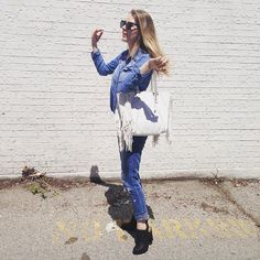 L.K Britton in Mendocino denim shirt, The Gap boyfriend-fit jeans, with fringed purse and slingback mules from Marshalls.