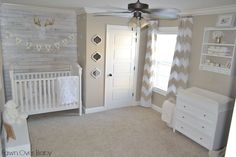 Love the white wash wood wall and floor to ceiling curtains