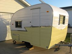 vintage travel trailer, nice paint job love the yellow and white and how the silver finishes it off so nicely!