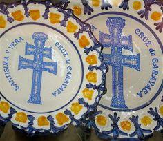 Caravaca cross depicted on ceramic plates in the church in Caravaca de la Cruz, Murcia, Spain