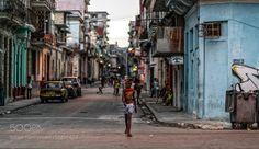 Boy in the street Havana Cuba. by andygallacher