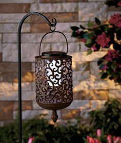 The chic scrollwork design of this Solar Scrolled Hanging Lantern refreshes the look of your porch, patio or other outdoor oasis with graceful accent lighting. A ring on the handle makes it easy to hang from any hook. It has a solar panel on top that Solar Powered Lanterns, Solar Lanterns, Candle Lanterns, Backyard Lighting, Outdoor Lighting, Outdoor Decor, Accent Lighting, Solar Pathway Lights, Solar Lights