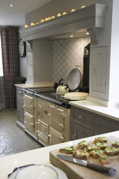 Luxury Bespoke Kitchen, Harpenden, Hertfordshire. LOVE LOVE LOVE the cream Aga against the soft grey of the units. Those little lights above the shelf really lift the room. Why not head on over to join our FREE interior design resource library at www.FlorenceAndFreya.com?