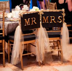 Bride and groom chairs Mr. and Mrs. signs for wedding chairs