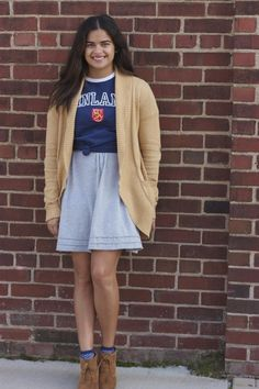 graphic tee tied over dress, socks poking out of booties
