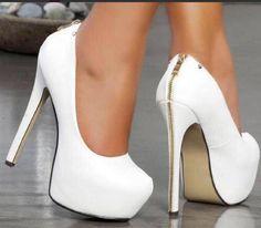 White platform pumps with zip running from heel to heel tip