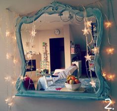 Painted mirror with lights draped on it.  For Z.