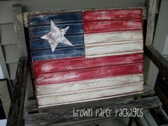 beadboard flag by brown paper packages, tutorial - love the distressed, rustic look and would be perfect for 4th of July, patriotism, and it also reminds me of the Lone Star (Texas) flag, could be made that way. Great country decor - I'd leave this up year-round! (also pinned on my wall dec board)