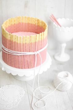 Sweet pink cake adorned with pocky sticks.