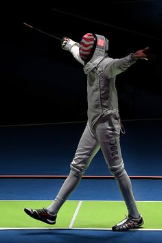 #RIO2016 Miles ChamleyWatson of the United States celebrates against Timur Safin of Russia during a Men's Foil Team Semifinal bout on Day 7 of the Rio 2016...