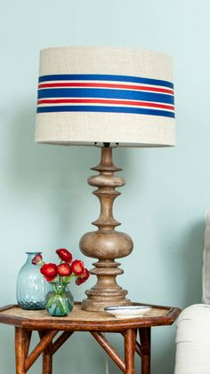 Line a ribbon with Glue Dots and, starting at the shade's seam, wrap tautly around lamp shade for this grain sack-inspired craft.