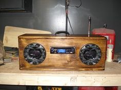 This is a homemade camping radio that I made from a piece of wood , A car stereo ,speakers and a power converter .The sound is incredible.It is a car stereo, cd player, with a jack to play music from your ipod .In my younger years i bought my first mechanics tool box and decided i wanted to put a car stereo in it .So i bought a stereo, a set of speakers and a 12 volt converter . As the years went by the novelty kinda wore off. &n...