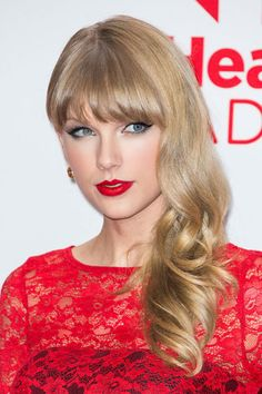 Taylor Swift's Beauty Transformation - 2012: Swift gets catty in noir liner and red lips at the iHeartRadio Music Festival.