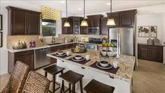 Dark cabinets contrast beautifully with light counters and flooring. New homes in Arroyo Norte built by Beazer Homes in New River, AZ.