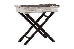 Деревянный, сервировочный столик с поддоном, явно, желает вам помочь  при подаче барбекю или шашлыков, весьма удобная вещь. Столик изготовлен в сером и черном, слегка состаренном, цвете.             Материал: Дерево.              Бренд: DG Home.              Стили: Прованс и кантри.              Цвета: Белый, Черный.