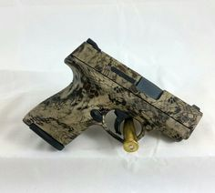 Kryptek Camo Done Right! This is our in house cerakote hybrid. Smith & Wesson Bodyguard, Smith Wesson, How To Paint Camo, Camo Paint, Tactical Equipment, Tactical Gear, M&p Shield 9mm, Camo Guns, Glock Guns
