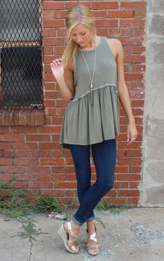 Anywhere Tank – Olive by POL  Empire style top with crochet trim around waist, neckline and around the deep cut armholes. This is a soft olive fabrication with exposed zipper in back.