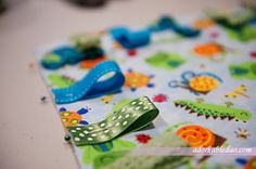 diy ribbon taggy baby blanket. Looks cute and pretty easy?