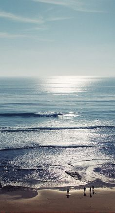 San Diego beach • photo: Johnny Lucus   Love how you can hardly tell where the ocean stops and the sky starts.